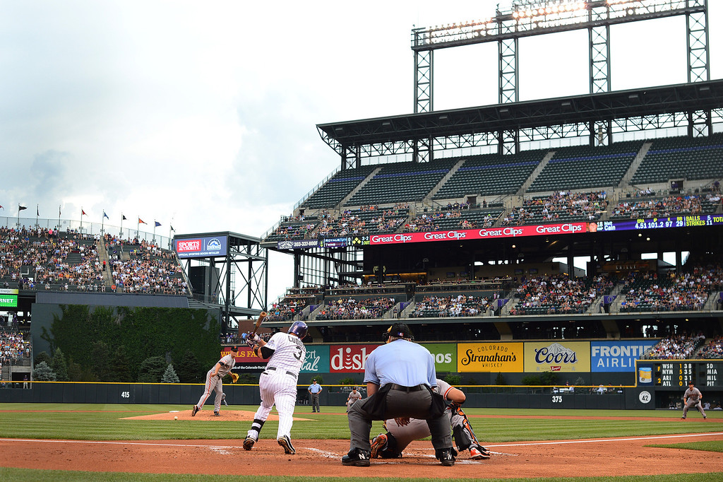 . Michael Cuddyer #3 of the Colorado Rockies gets a hit in the first inning against the San Francisco Giants to extend his hitting streak to 26 games during the game at Coors Field on June 29, 2013 in Denver, Colorado. Photo by Garrett W. Ellwood/Getty Images)