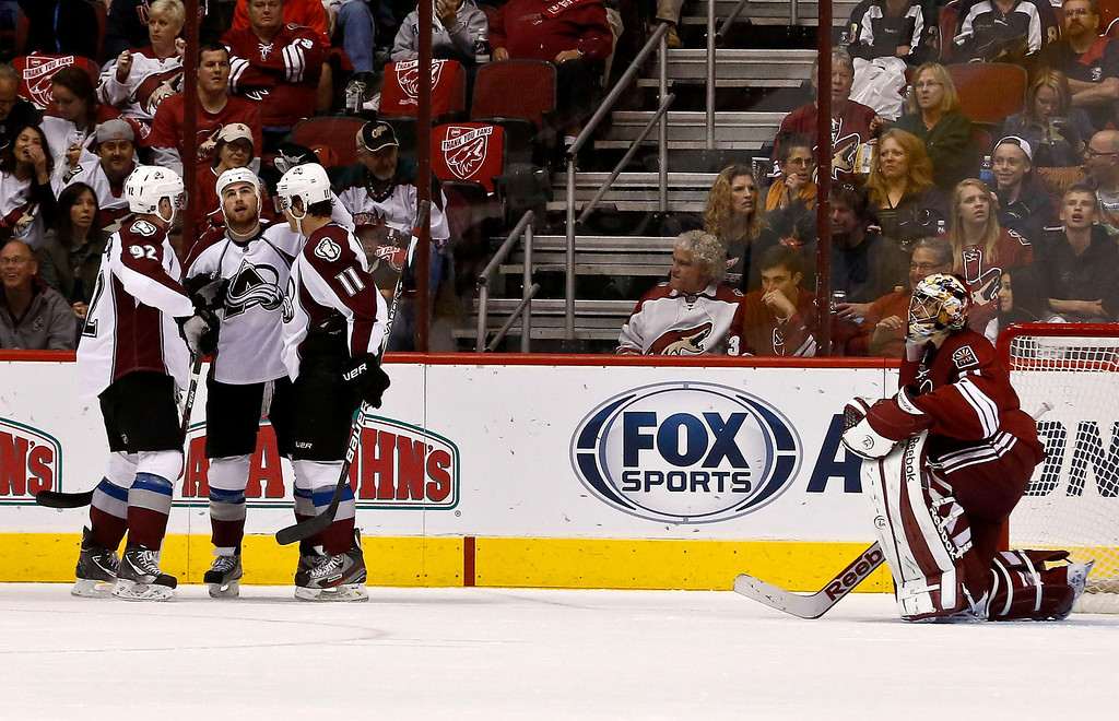 . Colorado Avalanche\'s Ryan O\'Reilly celebrates his goal against Phoenix Coyotes\' Mike Smith, right, with teammates Gabriel Landeskog (92), of Sweden, and Jamie McGinn (11) during the second period in an NHL hockey game, on Friday, April 26, 2013, in Glendale, Ariz. (AP Photo/Ross D. Franklin)