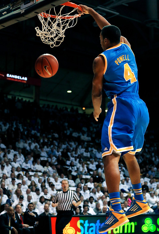 . UCLA\'s Norman Powell dunks during the first half of an NCAA college basketball game against Colorado in Boulder, Colo., Thursday, Jan. 16, 2014. (AP Photo/Brennan Linsley)