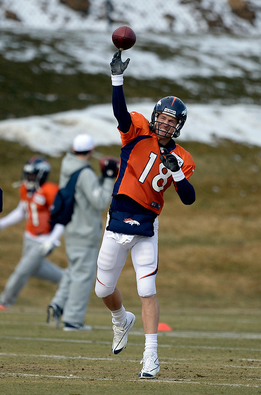 . Denver Broncos quarterback Peyton Manning (18) throws a pass during practice January 15, 2014 at Dove Valley. The Broncos are preparing for their game against the New England Patriots in the AFC championship game.  (Photo by John Leyba/The Denver Post)