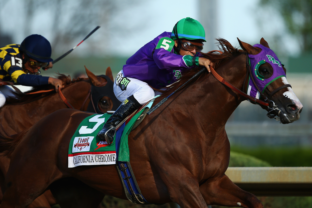Description of . California Chrome #5, ridden by Victor Espinoza, pulls away from Chitu #13, ridden by Martin Garcia, coming out of the fourth turn enroute to winning the 140th running of the Kentucky Derby at Churchill Downs on May 3, 2014 in Louisville, Kentucky.  (Photo by Andy Lyons/Getty Images)