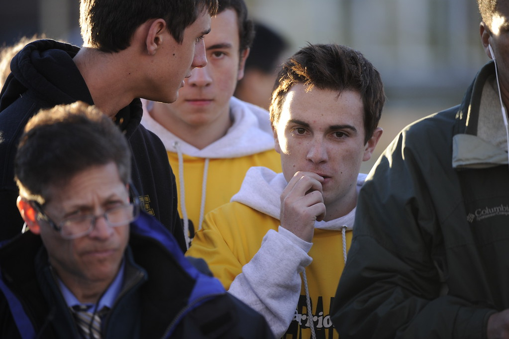 . A small group of Arapahoe High School students listened to Sheriff Grayson Robinson\'s press conference on the north lawn of the school Saturday afternoon.  Photo By Karl Gehring/The Denver Post