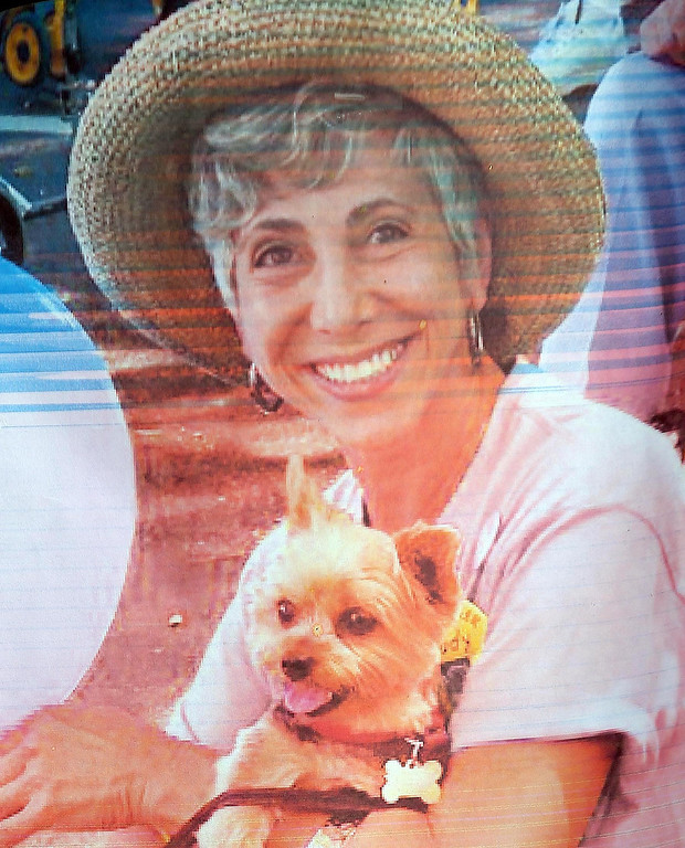 . A photo of homicide victim Judy Salamon, 66, is seen at a memorial for her on Fern Street in Oakland, Calif., on Thursday, July 25, 2013. Salamon was shot and killed Wednesday afternoon while driving a few blocks from her home in Oakland\'s Fairfax district, marking the city\'s 56th homicide of the year. (Jane Tyska/Bay Area News Group)