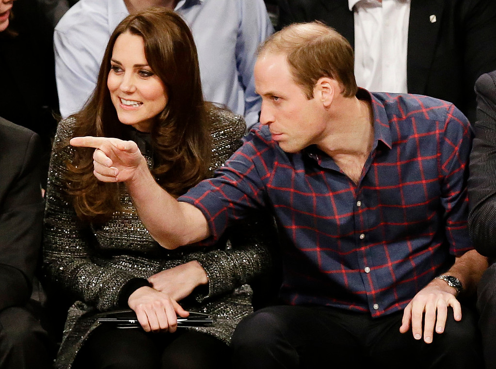 . Britain\'s Prince William, right, and Kate, Duchess of Cambridge, watch the second half of an NBA basketball game between the Brooklyn Nets and the Cleveland Cavaliers, Monday, Dec. 8, 2014, in New York. (AP Photo/Frank Franklin II)