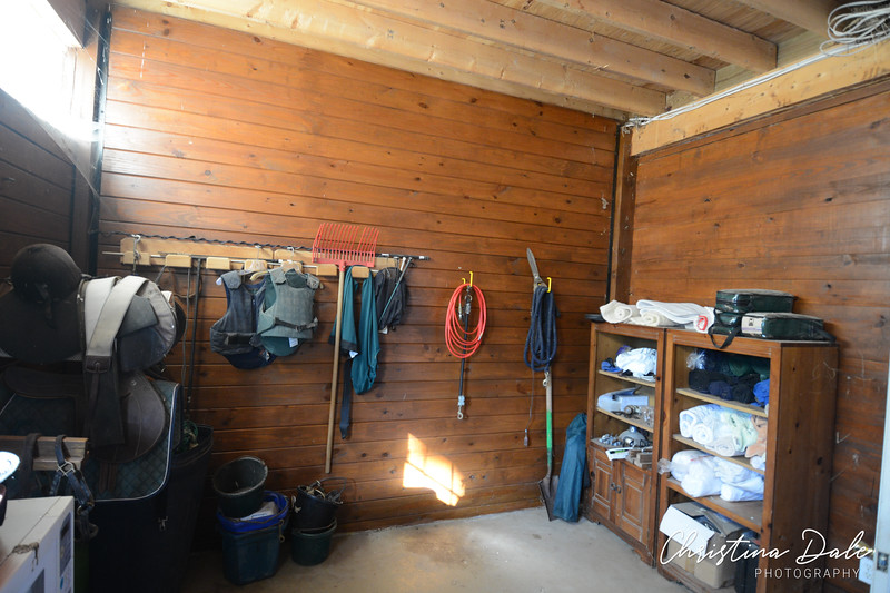 Tack room, includes 1/2 bath and closet with hot water heater and fly system.