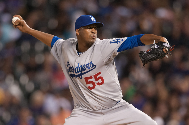 . Roberto Hernandez #55 of the Los Angeles Dodgers pitches against the Colorado Rockies during a game at Coors Field on September 15, 2014 in Denver, Colorado.  (Photo by Dustin Bradford/Getty Images)
