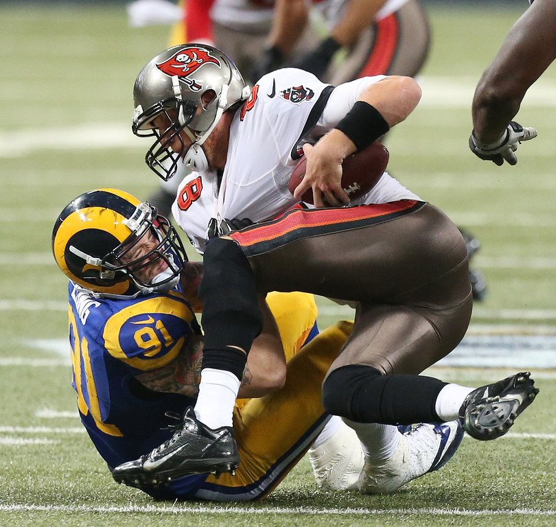 . St. Louis Rams defensive end Chris Long sacks Tampa Bay Buccaneers quarterback Mike Glennon for an 8-yard loss during the fourth quarter of an NFL football game Sunday, Dec. 22, 2013, in St. Louis. The Rams won 23-13. (AP Photo/St. Louis Post-Dispatch, Chris Lee)