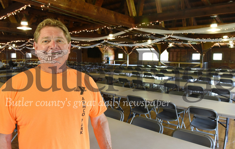 Harold Aughton/Butler Eagle: John Gibson, the property manager of the YMCA Armco Park stands in the Armco Hall, which was built in 1937.