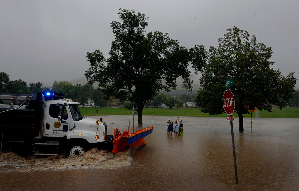 . BOULDER, CO. - SEPTEMBER12:  A group of youths gather on Balsam Ave in Boulder CO September 12, 2013. Record-breaking rain turned normally quiet creeks into raging, brown torrents that swept through Boulder on Thursday, flooding homes, swamping cars and closing roads and schools. (Photo By Craig F. Walker / The Denver Post)