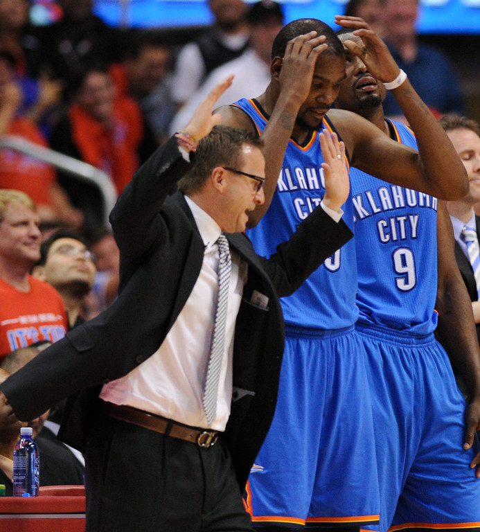 . Thunder coach Scott Brooks and Kevin Durant react after watching a replay of a foul called on Durant at the end of the third quarter. (Photo by Michael Owen Baker/Los Angeles Daily News)