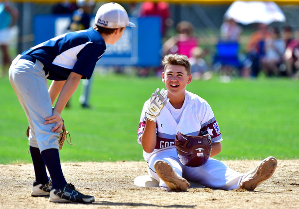 8/10/2019 Mike Orazzi | Staff Rhode Islands Barrington Little League's Cullen Crain (2) talks with New Hampshires Goffstown Junior Baseball Little League's Noah Durham (21) as they wait for a replay to be decided at Breen Field in Bristol, Conn., during the New England Regional Final on Saturday.