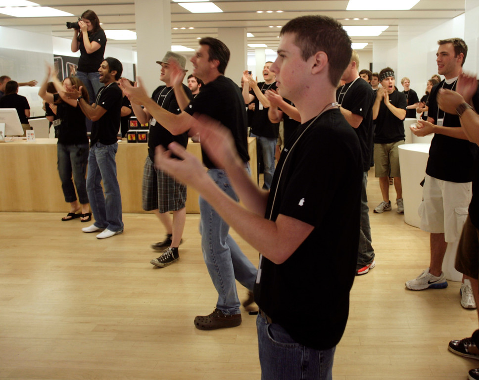 . Employees clap as customers enter to purchase the Apple iPhone at the Apple store in the tony Cherry Creek Mall in east Denver on Friday, June 29, 2007.  Some of the purchasers spent hours in line for a chance to get the phone. (AP Photo/David Zalubowski)