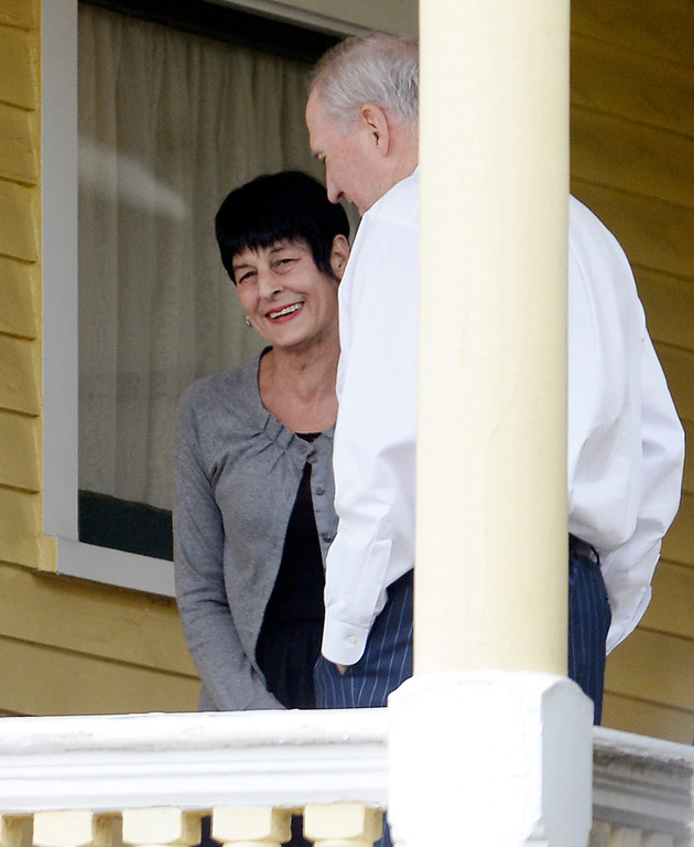 . Terri Hernandez, left, stands on the porch of the O\'Brien Funeral Home before a private service for her son Aaron Hernandez, Monday, April 24, 2017, in Bristol, Conn. The former New England Patriots tight end was found hanged in his cell in a maximum-security prison in Massachusetts on April 19, 2017. (AP Photo/Jessica Hill)