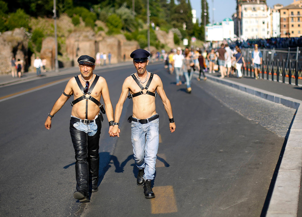 . A gay couple walk during the annual gay pride parade in downtown Rome June 15, 2013. REUTERS/Max Rossi