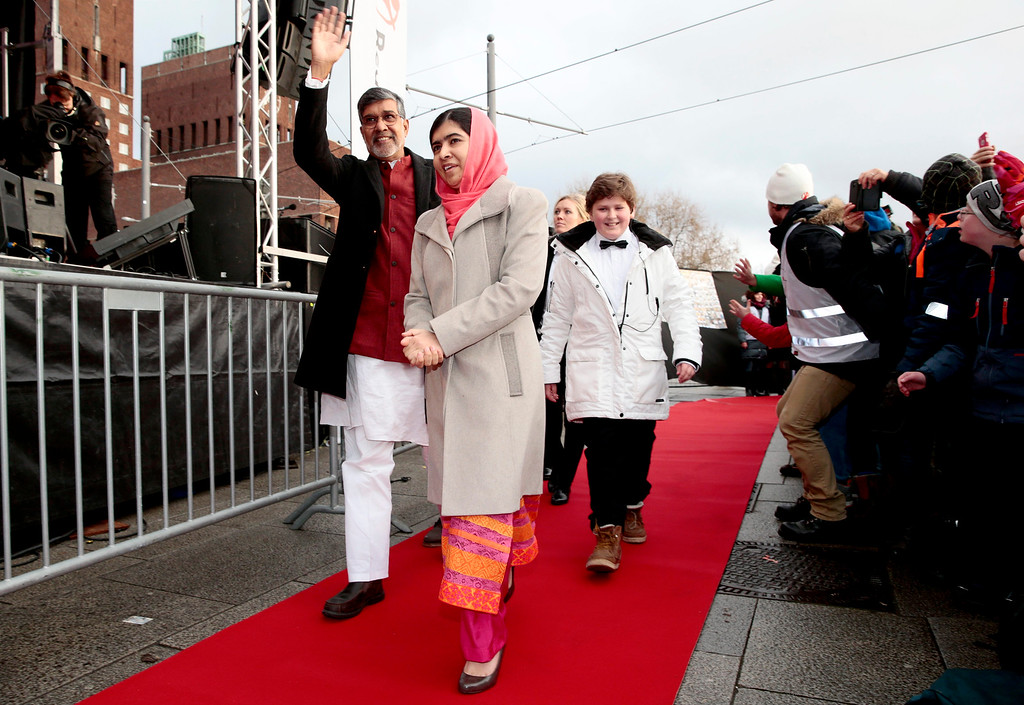 . Nobel Peace Prize laureates Kailash Satyarthi, left, and Malala Yousafzai arrive at Save the Children (Redd Barna) peace prize festivities in Oslo, Wednesday, Dec. 10, 2014. (AP Photo/NTB Scanpix, Hakon Mosvold Larsen)  NORWAY OUT