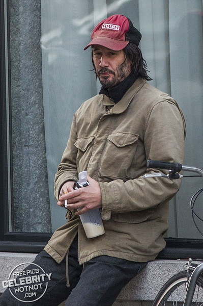 Keanu Reeves Wears His Arch Motorcycle Cap Taking A Break From Filming In Montreal, Canada