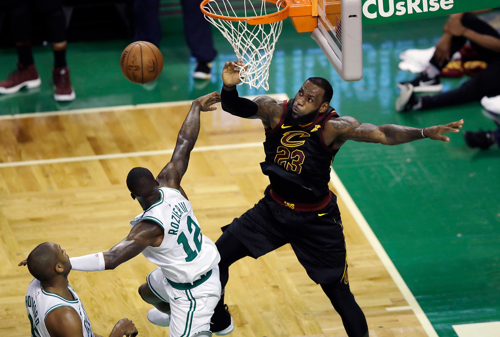 . Cleveland Cavaliers forward LeBron James blocks a shot by Boston Celtics guard Terry Rozier (12) during the second half in Game 7 of the NBA basketball Eastern Conference finals, Sunday, May 27, 2018, in Boston. (AP Photo/Charles Krupa)