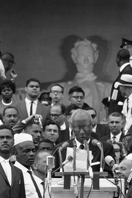 . A. Philip Randolph, one of the leaders of the March on Washington demonstration, stands on crowded platform on steps of Lincoln Memorial as he speaks to crowd following the parade which brought the civil rights demonstrators to the memorial area in Washington, August 28, 1963. (AP Photo)