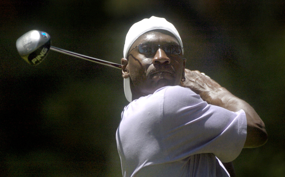 Description of . Michael Jordon tees off at the American Century Championship Celebrity Amateur Tournament at Edgewood in Stateline, Nev. on Thursday, July 14, 2005. (AP Photo/Reno Gazette-Journal, Candice Towell)