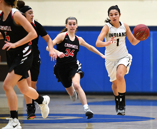 2/8/2020 Mike Orazzi | StaffrNewington's Sabrina Soler (1) and Cromwell's Marykate Sullivan (34) on Saturday morning in Newington.