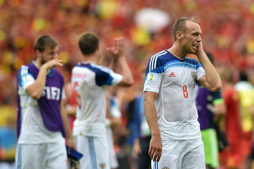 . Russia\'s midfielder Denis Glushakov reacts att he end of the Group H football match between Belgium and Russia at the Maracana Stadium in Rio de Janeiro during the 2014 FIFA World Cup on June 22, 2014. AFP PHOTO / KIRILL KUDRYAVTSEV