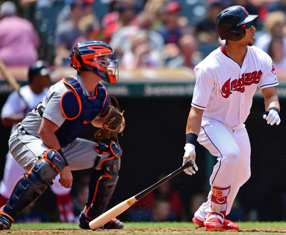 . Cleveland Indians\' Michael Brantley, right, watches his two-RBI single in the second inning of a baseball game against the Detroit Tigers, Sunday, June 24, 2018, in Cleveland. (AP Photo/David Dermer)