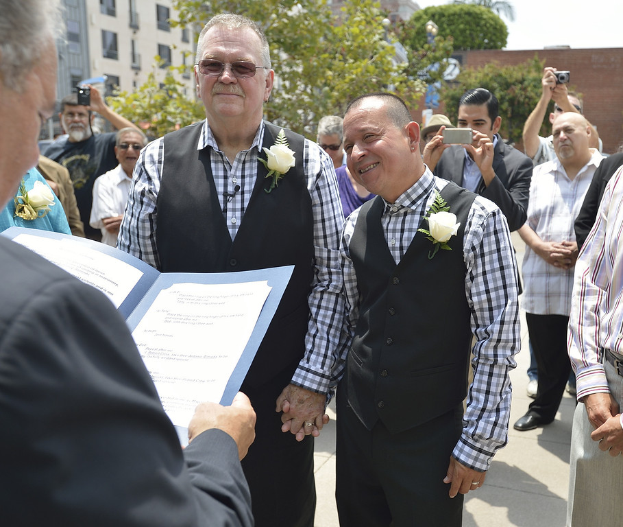 . LONG BEACH, CALIF. USA -- Long Beach residents Bob Crow, right, and Tony Almeida, get married at Harvey Milk Plaza in Downtown Long Beach, Calif., on July 1, 2013. Long Beach Mayor Bob Foster performed the marriage ceremony for the couple. Crow, who founded Long Beach Pride, asked Foster to perform the ceremony years ago.  Photo by Jeff Gritchen / Los Angeles Newspaper Group