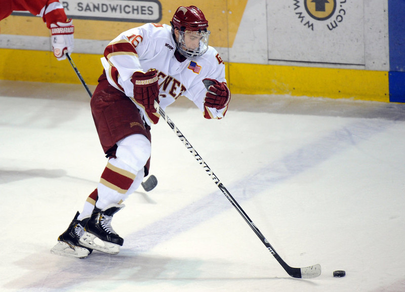. University of Denver\'s Zac Larraza is in action during the 2nd period of the game against Boston University at Magness Arena in Denver, Colo. on Saturday, December 29, 2012. Hyoung Chang, The Denver Post
