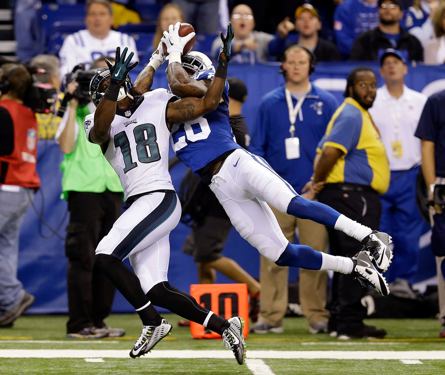 . Indianapolis Colts Greg Toler makes an interception against Philadelphia Eagles wide receiver Jeremy Maclin (18) during the first half of an NFL football game Monday, Sept. 15, 2014, in Indianapolis. (AP Photo/Michael Conroy)