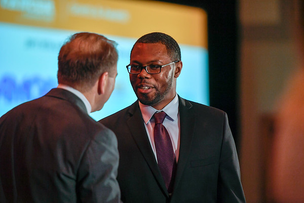 2017 Resident Travel Award Recipient Lionel Kankeu Fonkoua, MD with Thomas G. Roberts, Jr., MD, Chair of the Conquer Cancer Foundation Board of Directors, during 2017 Grants & Awards Ceremony and Reception