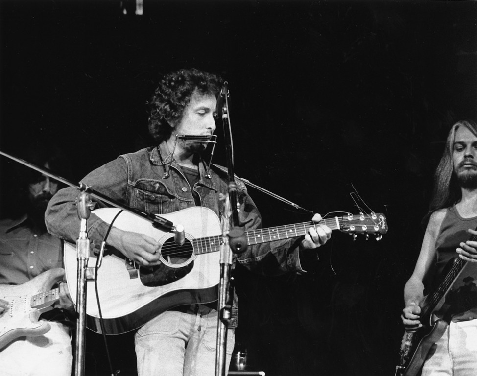 . Bob Dylan is seen performing at a benefit concert for Bangladesh refugees at Madison Square Garden in New York City on Aug. 1, 1971. Former Beatle George Harrison is playing the guitar behind Dylan. Leon Russell is on the right. (AP Photo)