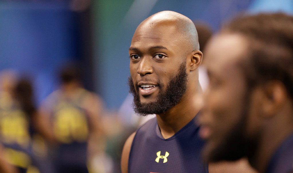 . LSU running back Leonard Fournette waits to be tested at the NFL football scouting combine Friday, March 3, 2017, in Indianapolis. (AP Photo/David J. Phillip)