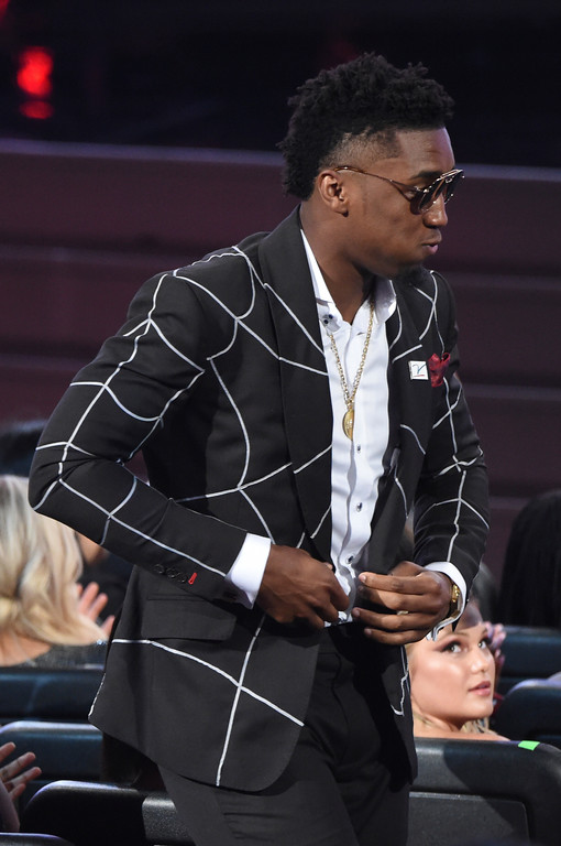. Utah Jazz\'s Donovan Mitchell  heads to the stage after winning the award for best breakthrough athlete at the ESPY Awards at Microsoft Theater on Wednesday, July 18, 2018, in Los Angeles. (Photo by Phil McCarten/Invision/AP)