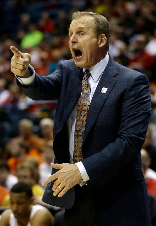 . Texas head coach Rick Barnes directs his team during the first half of a second round NCAA college basketball tournament game against the Arizona State Thursday, March 20, 2014, in Milwaukee. (AP Photo/Morry Gash)