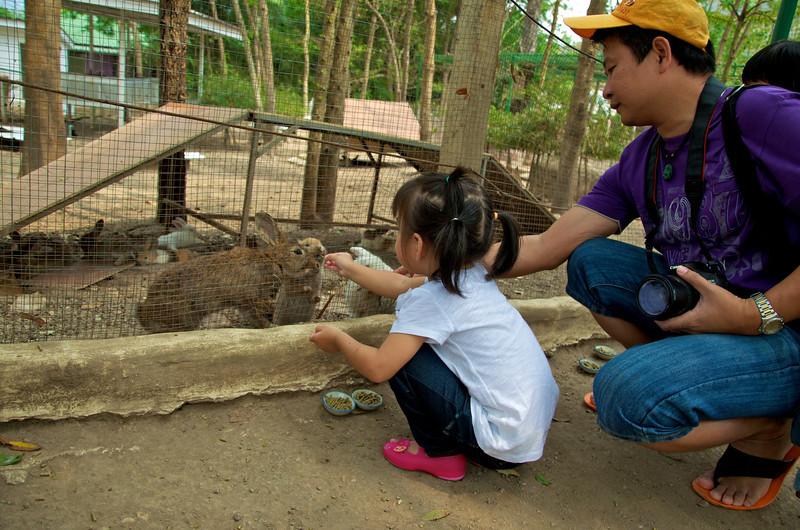 PF feeding rabbits at the rabbit farm.jpg