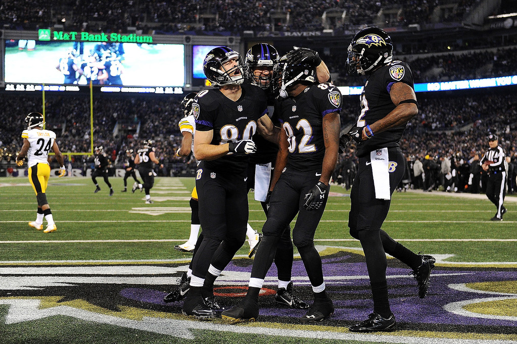 . Torrey Smith #82 of the Baltimore Ravens celebrates after scoring a touchdown in the first quarter of an NFL game against the Pittsburgh Steelers at M&T Bank Stadium on November 28, 2013 in Baltimore, Maryland.  (Photo by Patrick Smith/Getty Images)