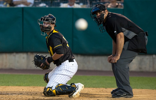 08/15/19 Wesley Bunnell | Staff The New Britain Bees vs the High Point Rockers at New Britain Stadium on Thursday, August 15, 2019. Catcher Logan Moore (30) and home plate umpire Mario Rosas watch a ball bounce foul towards the Rockers dugout.
