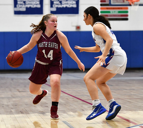 3/6/2020 Mike Orazzi | StaffrNorth Haven's Carly Fresher (14) and St. Paul's Lillian Sirois (12) during the Class L Second Round Girls State Tournament in Bristol on Friday night.