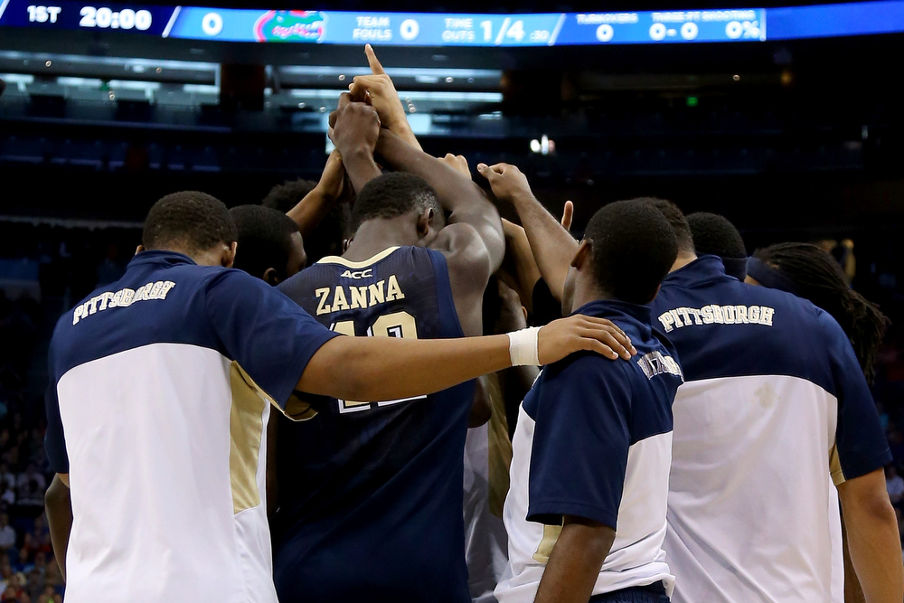 . The Pittsburgh Panthers huddle before taking on the Florida Gators during the third round of the 2014 NCAA Men\'s Basketball Tournament at Amway Center on March 22, 2014 in Orlando, Florida.  (Photo by Mike Ehrmann/Getty Images)