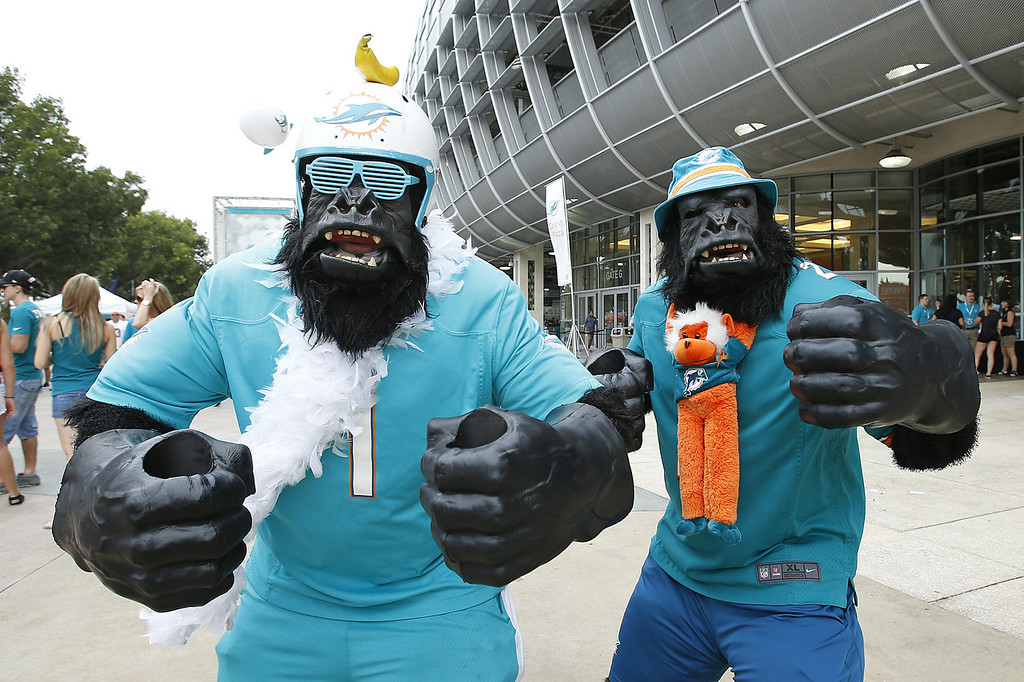 . Fans in costume walk in front of Sun Life Stadium prior to the game between the Miami Dolphins and the New York Jets on December 29, 2013 in Miami Gardens, Florida. (Photo by Joel Auerbach/Getty Images)