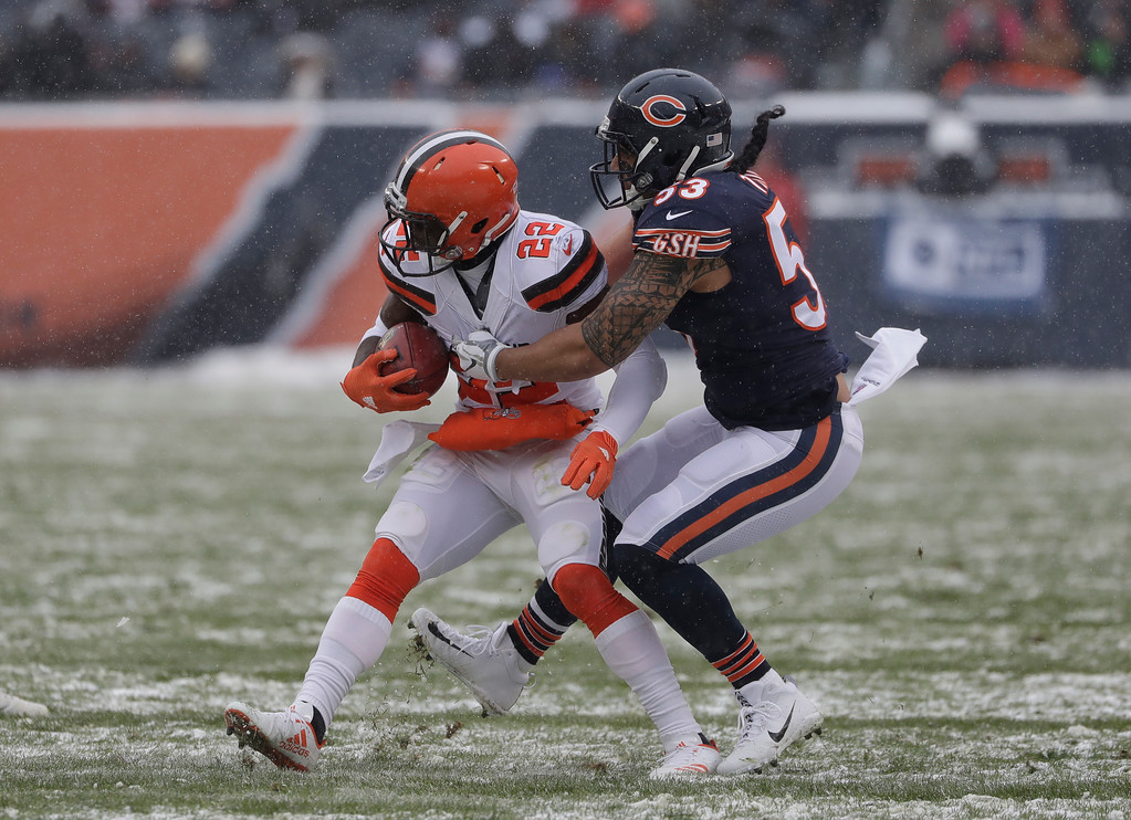 . Chicago Bears cornerback Kyle Fuller (23) brings down Cleveland Browns free safety Jabrill Peppers (22) during an NFL football game in Chicago, Sunday, Dec. 24, 2017. (AP Photo/Nam Y. Huh)