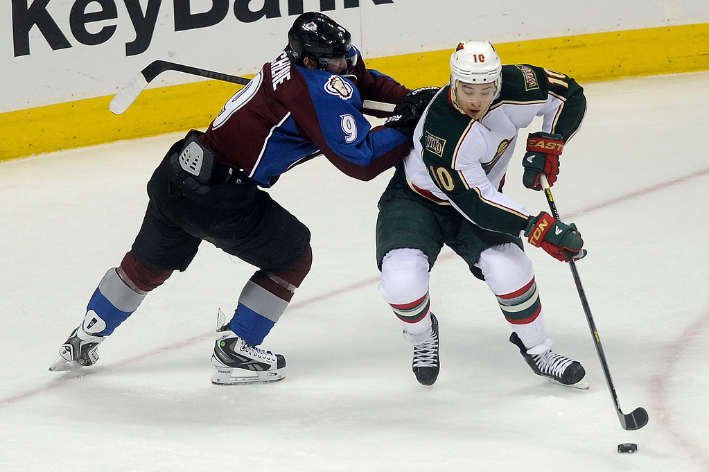 . Matt Duchene (9) of the Colorado Avalanche attempts to knock Devin Setoguchi (10) of the Minnesota Wild off the puck during the second period, Saturday, April 27, 2012 at Pepsi Center. Seth A. McConnell, The Denver Post