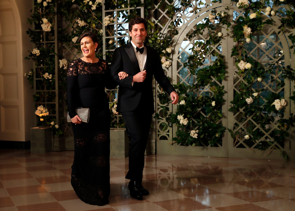 . White House press secretary Sarah Huckabee Sanders and her husband Bryan Sanders arrive for a State Dinner with French President Emmanuel Macron and President Donald Trump at the White House, Tuesday, April 24, 2018, in Washington. (AP Photo/Alex Brandon)