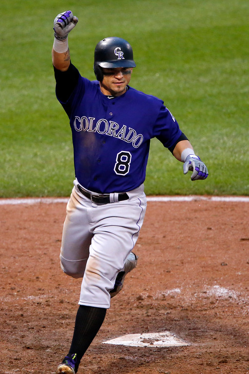 . Colorado Rockies\' Gerardo Parra celebrates as he scores the go-ahead run of a single by Rockies\' Tony Wolters off Pittsburgh Pirates relief pitcher Mark Melancon in the ninth inning of a baseball game in Pittsburgh, Saturday, May 21, 2016. A second run scored on the play on an error by Pirates first baseman John Jaso. The Rockies won 5-1. (AP Photo/Gene J. Puskar)