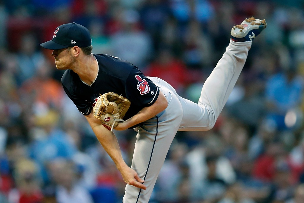 . Cleveland Indians\' Shane Bieber pitches during the first inning of a baseball game against the Boston Red Sox in Boston, Tuesday, Aug. 21, 2018. (AP Photo/Michael Dwyer)