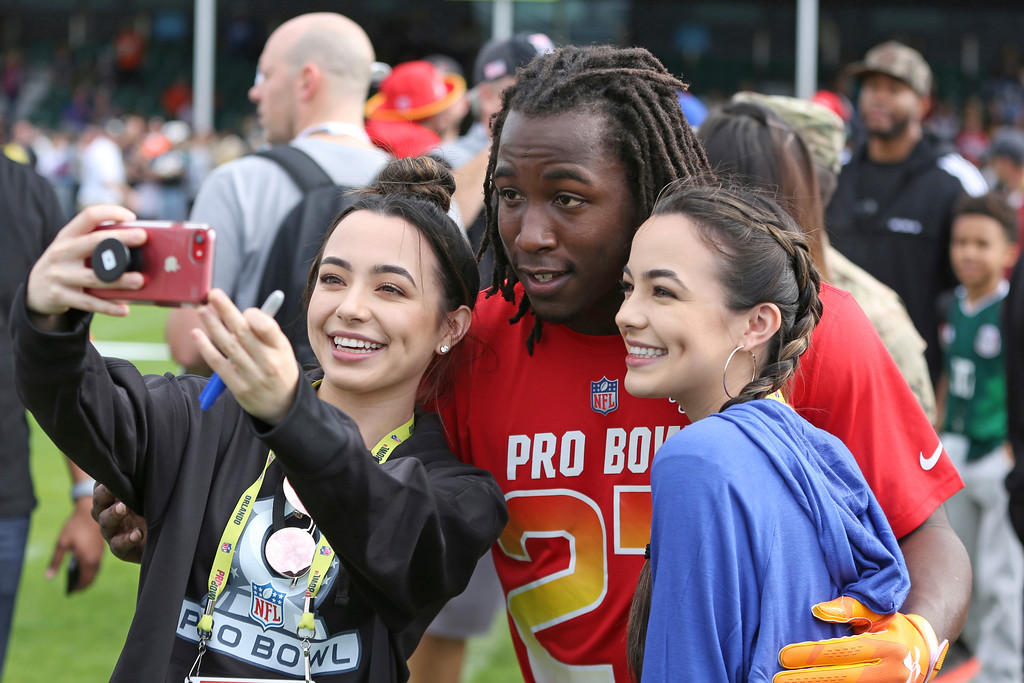 . AFC running back Kareem Hunt of the Kansas City Chiefs poses for a photo after Pro Bowl NFL football practice, Saturday, Jan. 27, 2018, in Kissimmee, Fla. (AP Photo/Gregory Payan)
