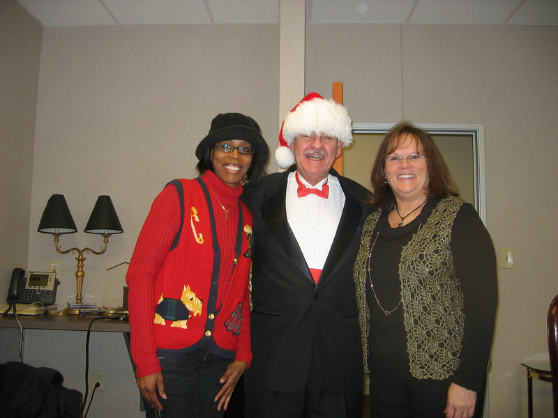 2010 12-16 First official closing for Central Indiana FC. Howeowner Elizabeth Hines (left) was on lease-purchase. Now, those lease payments have been transferred to her mortgage. Executive Director Chuck Vogt and Eileen Fisher dressed up to celebrate the occasion.