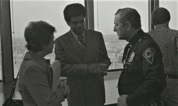 Police Officer Talking with City Officials
