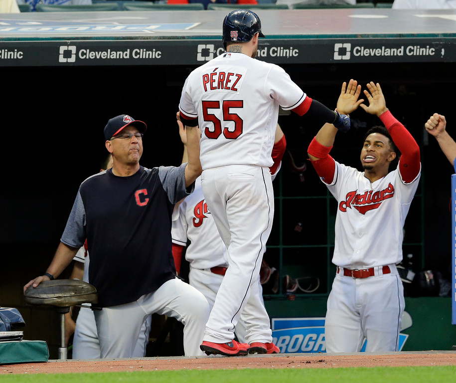 . Cleveland Indians\' Roberto Perez, center, is congratulated by Francisco Lindor, right, and manager Terry Francona after Perez hit a solo home run in the fifth inning of an interleague baseball game, Tuesday, June 13, 2017, in Cleveland. (AP Photo/Tony Dejak)