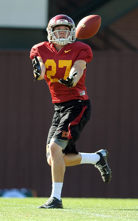. USC\'s David Mellstrom tries to haul in a pass during spring practice at USC Monday, April 1, 2014. (Andy Holzman/Los Angeles Daily News)